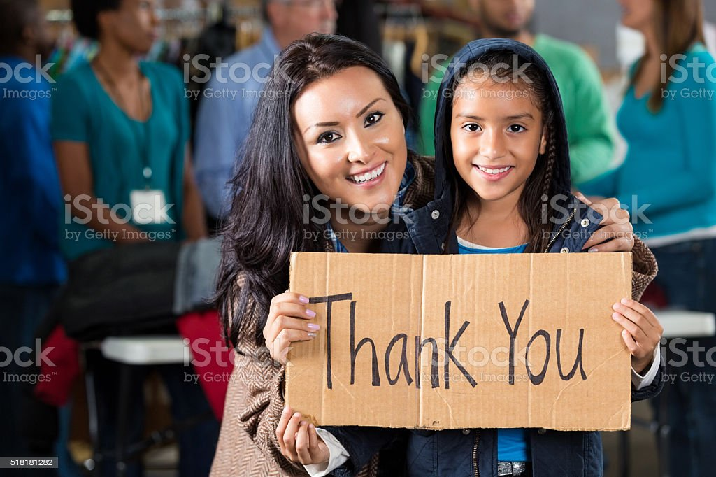 Mother and daughter at coat drive stock photo