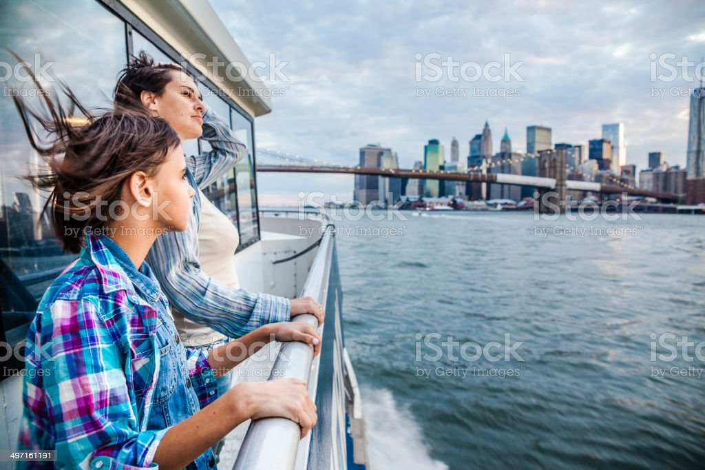 Mother and daughter at ferry at Hudson River stock photo