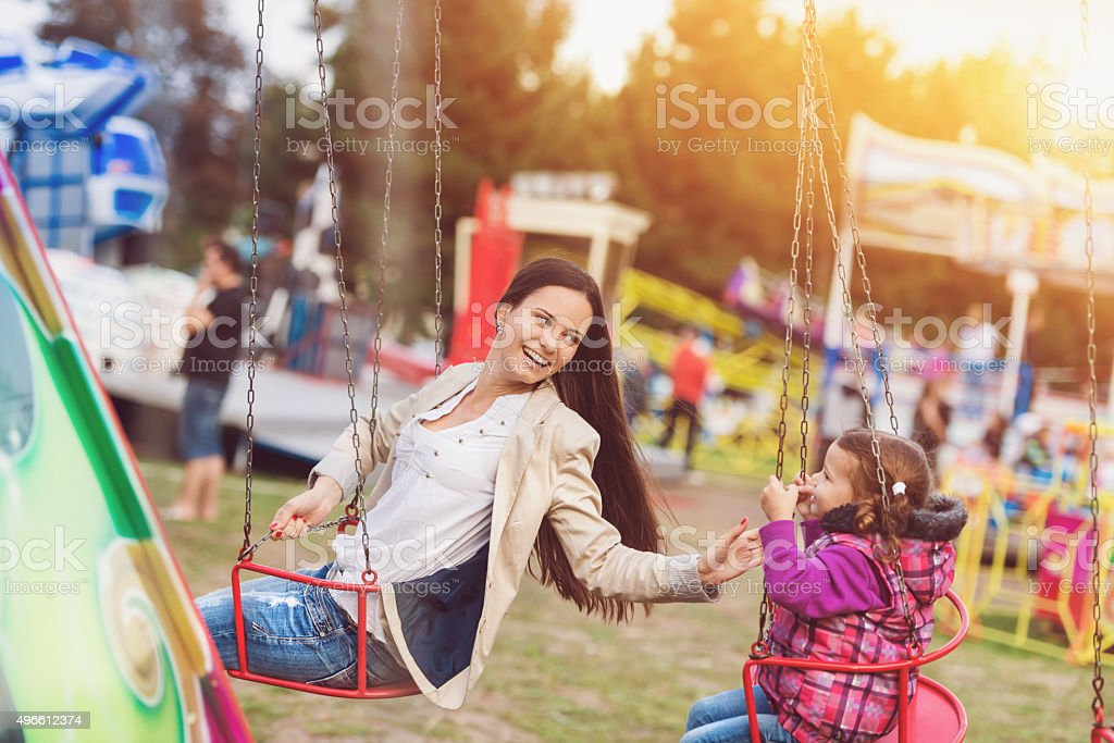 Mother and daughter at fun fair stock photo