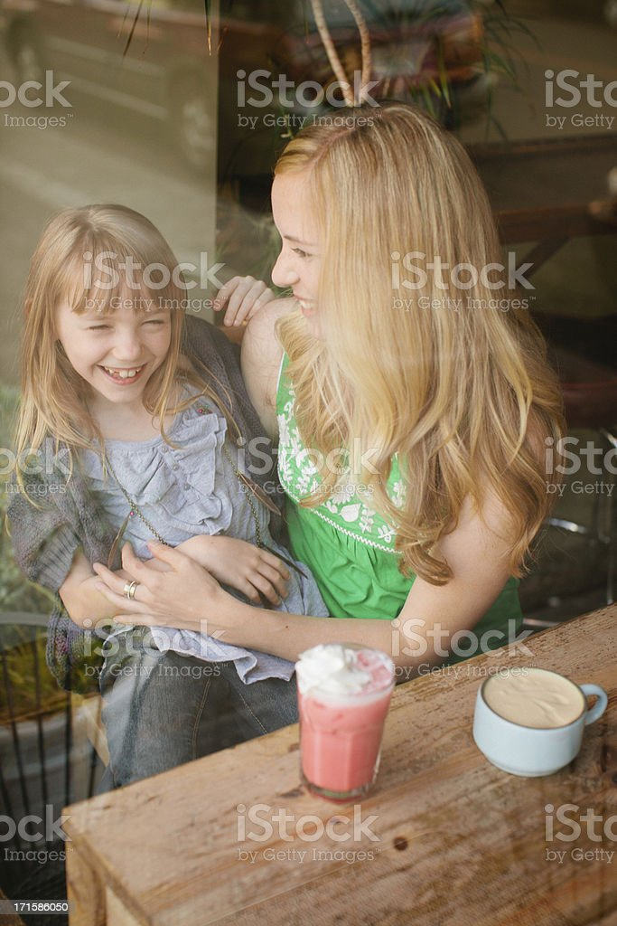 Mother and daughter at the coffee shop. stock photo