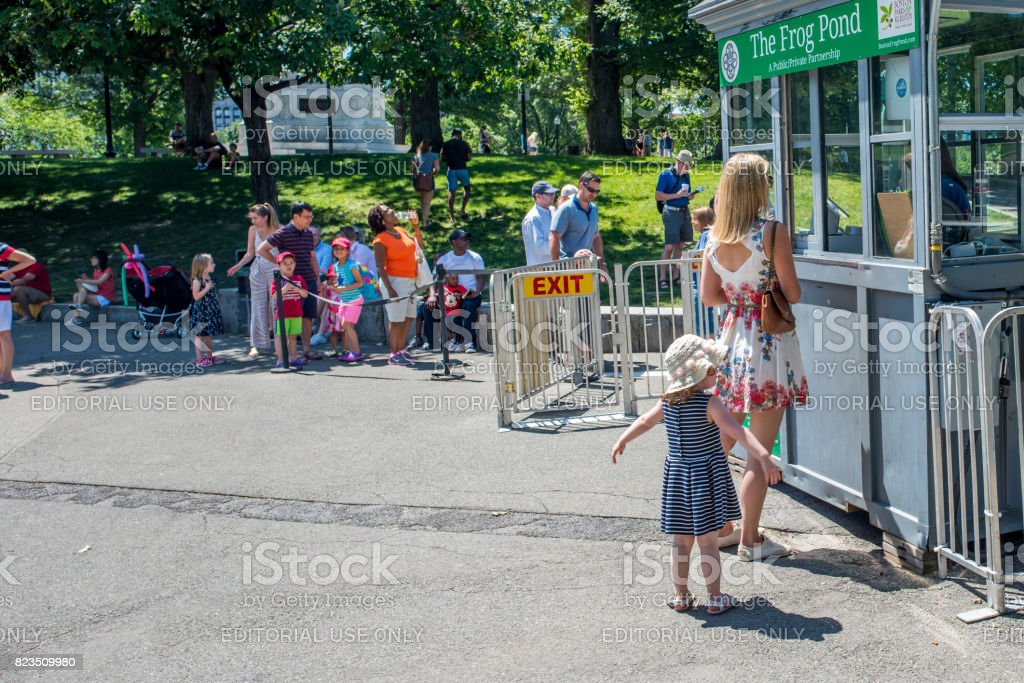 Mother and daughter at the Frog Pond in Boston Commons in summer stock photo