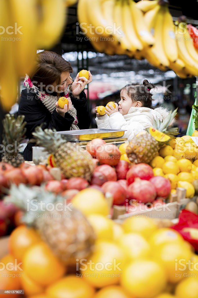 Mother and daughter at the market stock photo