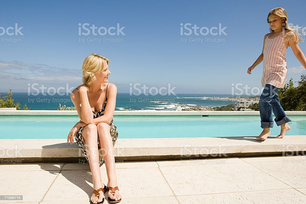 Mother and daughter at the poolside royalty-free stock photo