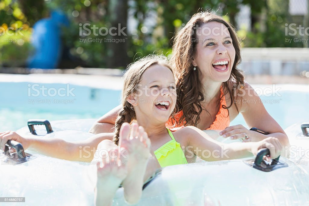 Mother and daughter at water park stock photo