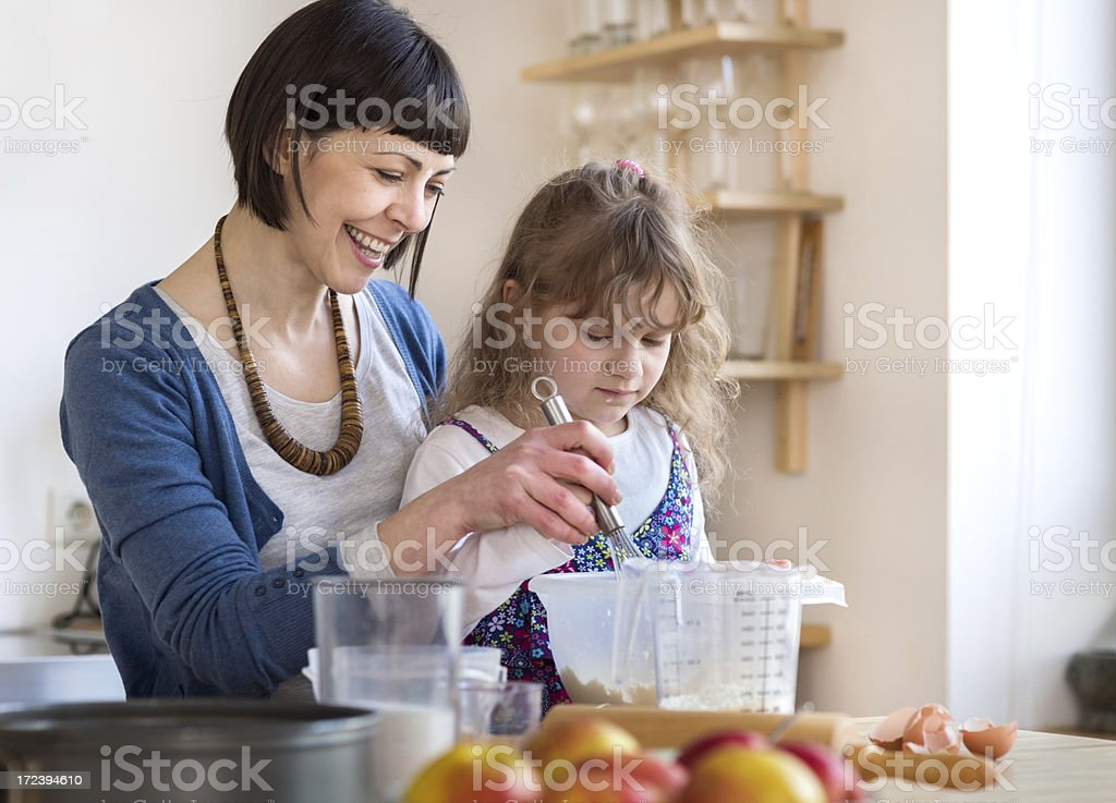 Mother and Daughter Baking a Cake Together royalty-free stock photo