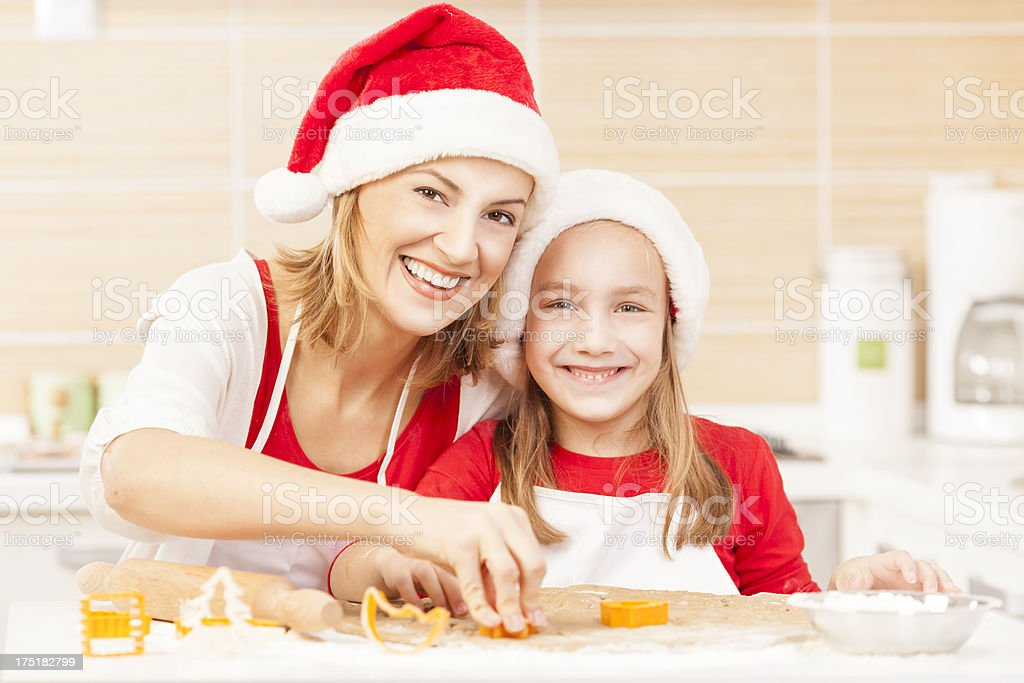 Mother and daughter baking Christmas cookies royalty-free stock photo