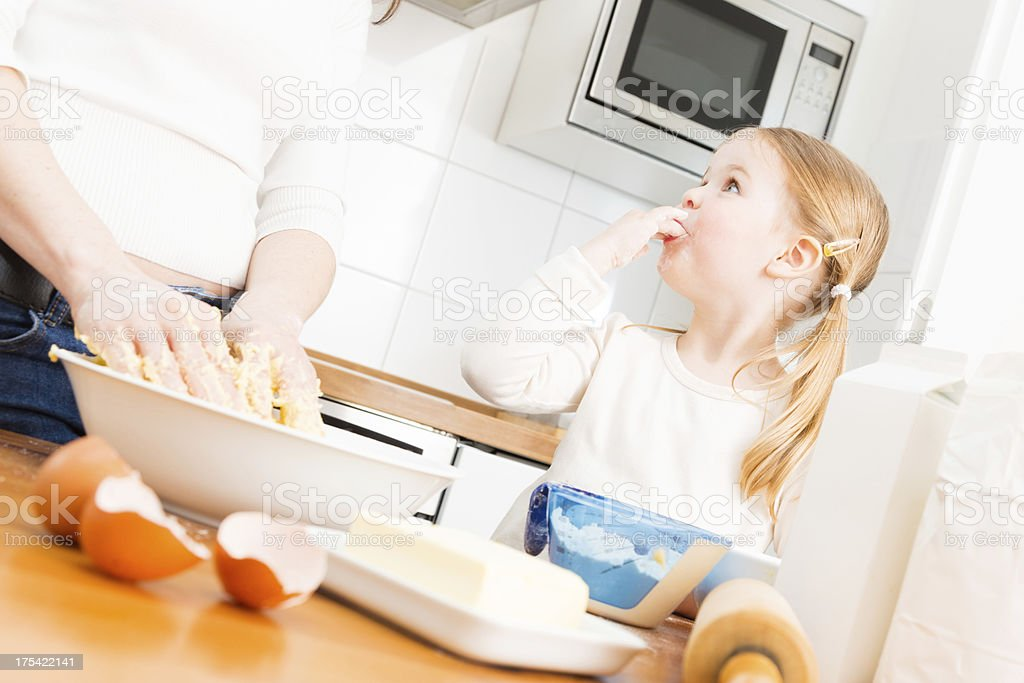 mother and daughter baking cookies royalty-free stock photo