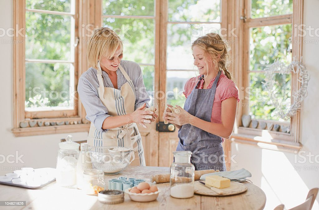 Mother and daughter baking in kitchen royalty-free stock photo