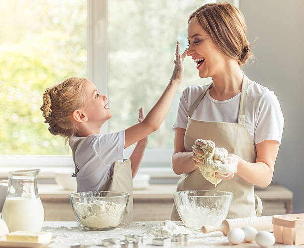 mother and daughter baking - kneading stock pictures, royalty-free photos & images