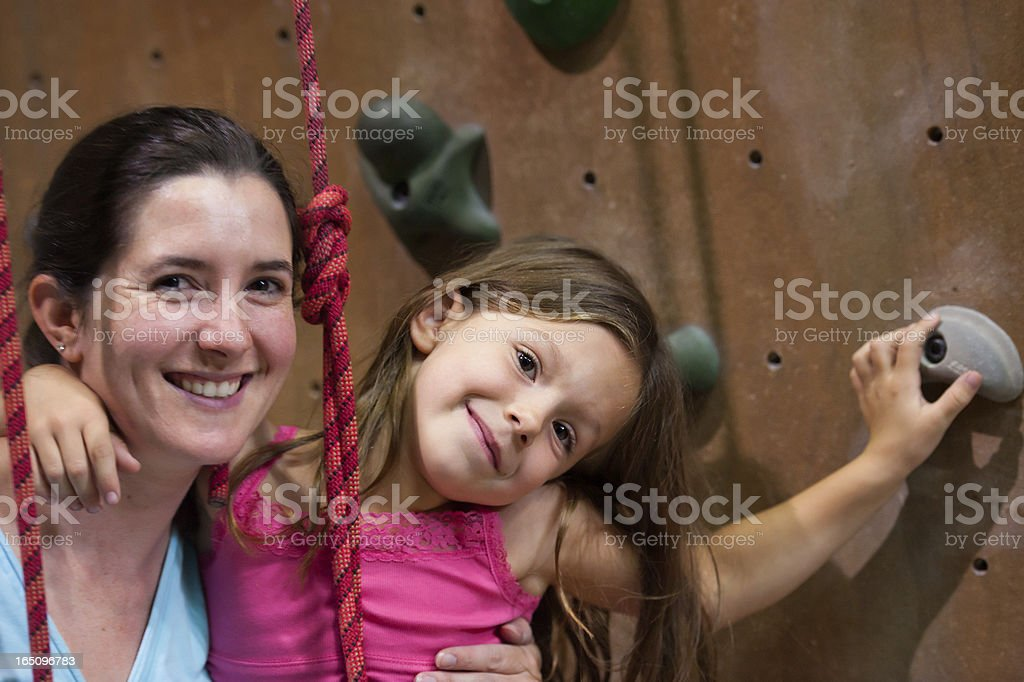 Mother and Daughter Bonding with Indoor Rock Climbing stock photo