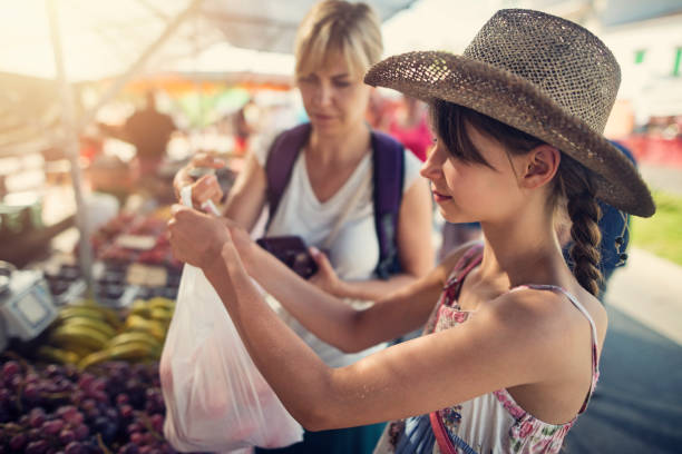 Mother and daughter buying fruit at the majorcan farmer's market stock photo