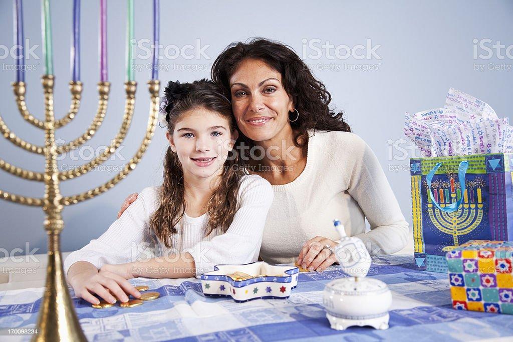 Mother and daughter celebrating Hanukkah royalty-free stock photo