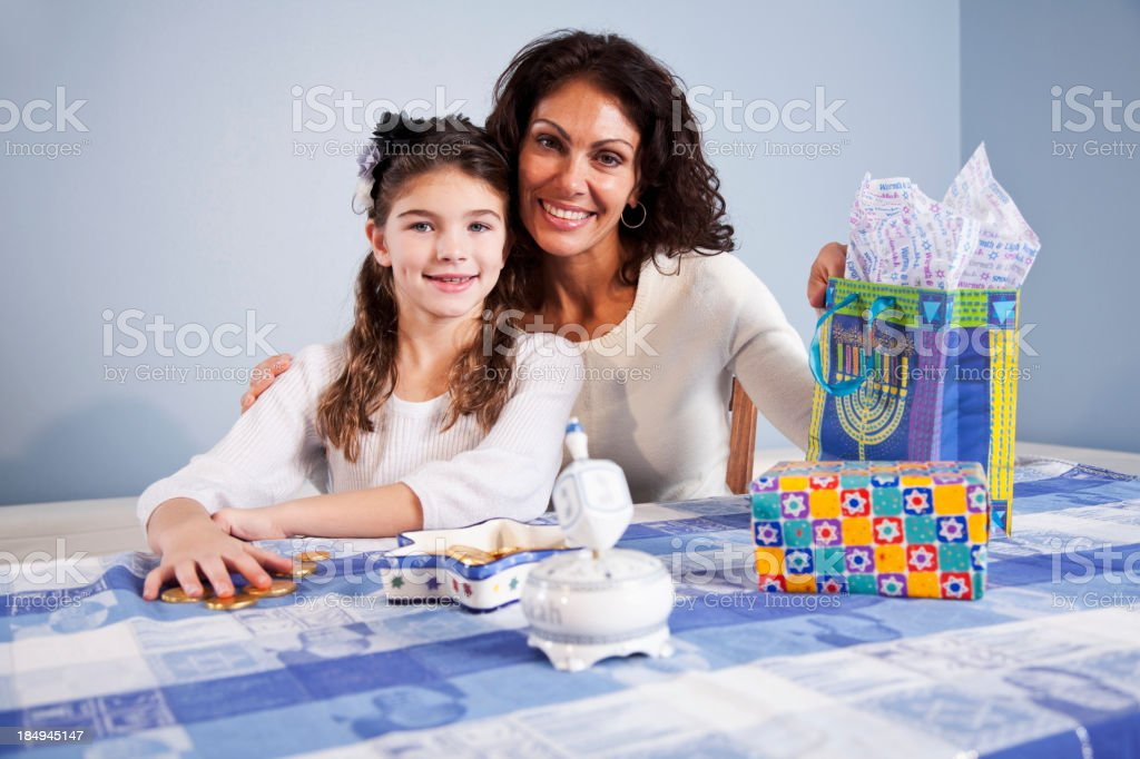 Mother and daughter celebrating Hanukkah stock photo