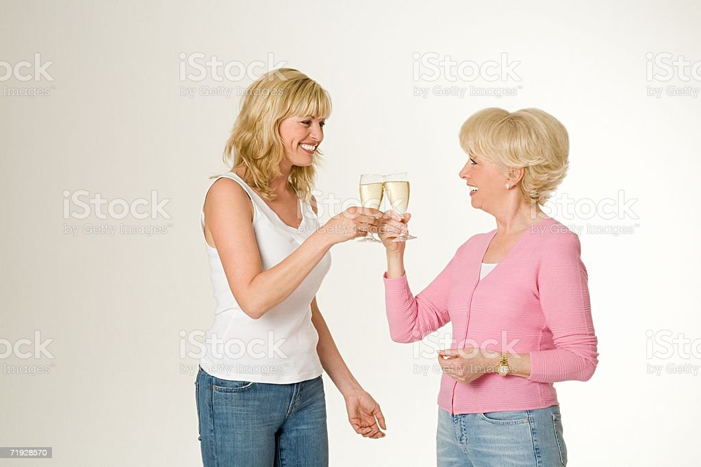 Mother and daughter celebrating royalty-free stock photo