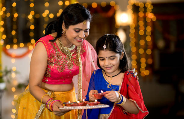 Mother and daughter celebrating traditional festival stock photo