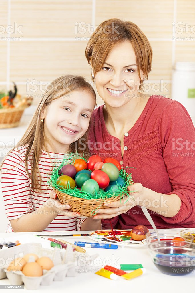 Mother and daughter coloring Easter eggs royalty-free stock photo