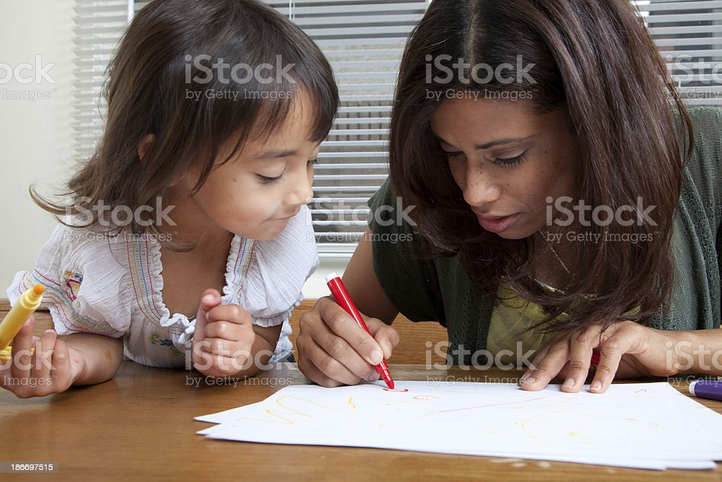 Mother and daughter coloring royalty-free stock photo