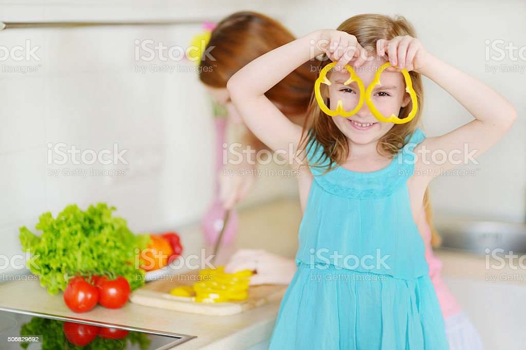Mother and daughter cooking dinner stock photo