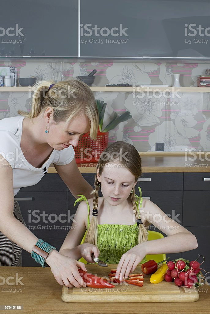 Mother and daughter cooking royalty-free stock photo