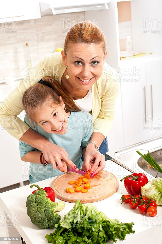 Mother and daughter cooking together royalty-free stock photo