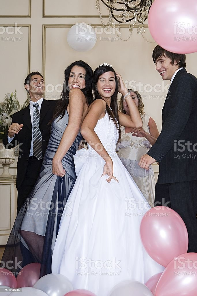 Mother and daughter dancing at quinceanera stock photo