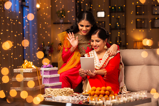 Mother and daughter diwali celebrate - stock photo