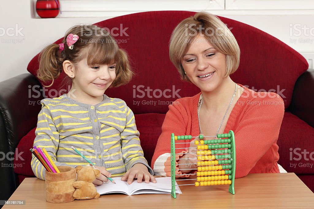 mother and daughter doing homework royalty-free stock photo