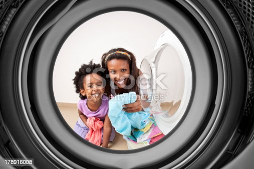 istock Mother and daughter doing laundry. 178916008