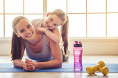 istock Mother and daughter doing sport 620737852