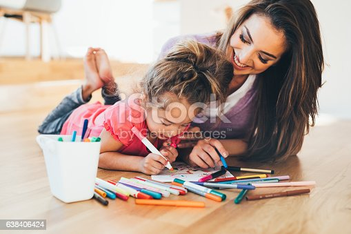 istock Mother and daughter drawing 638406424
