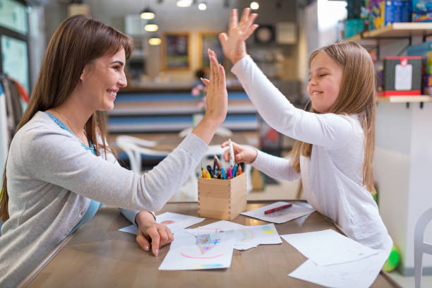 mother and daughter drawing - homework stock photos and pictures