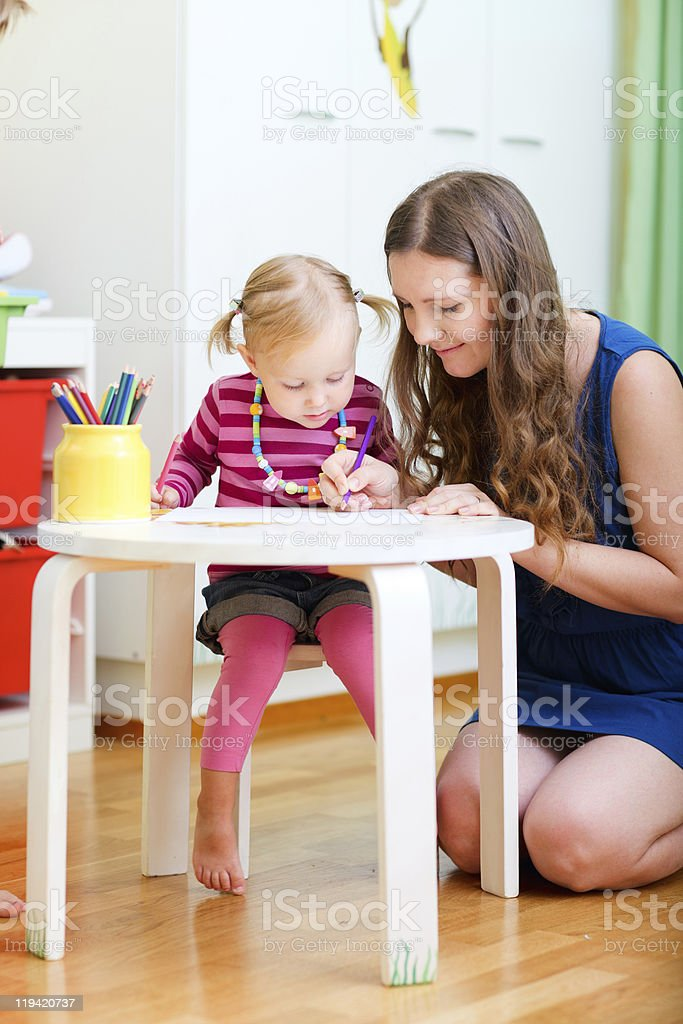Mother and daughter drawing together royalty-free stock photo
