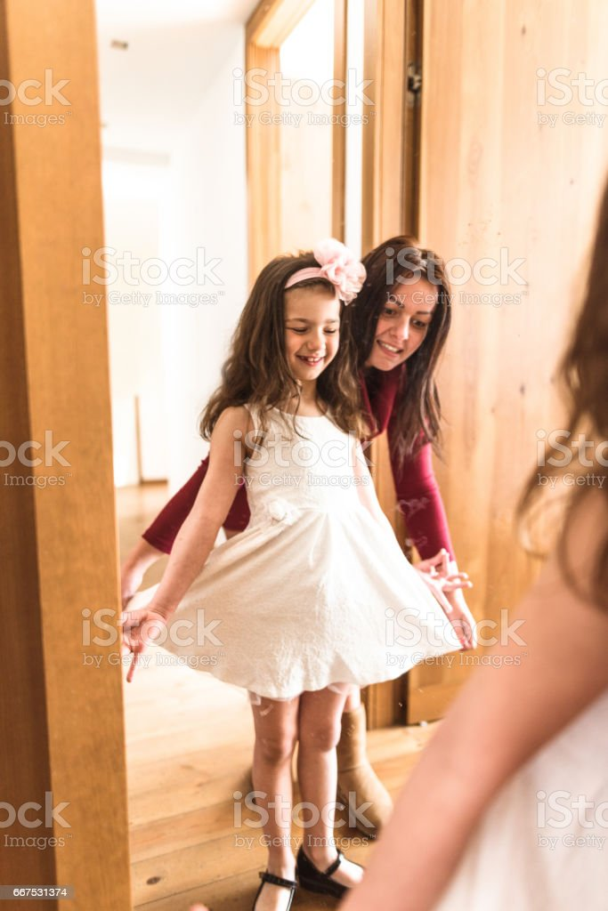 mother and daughter dressing up at the mirror foto stock royalty-free