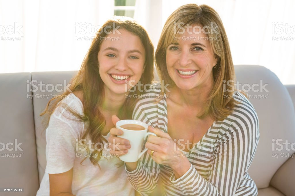 Mother and daughter drink tea royalty-free stock photo