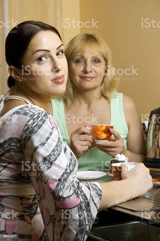 Mother and daughter drinking tea royalty-free stock photo