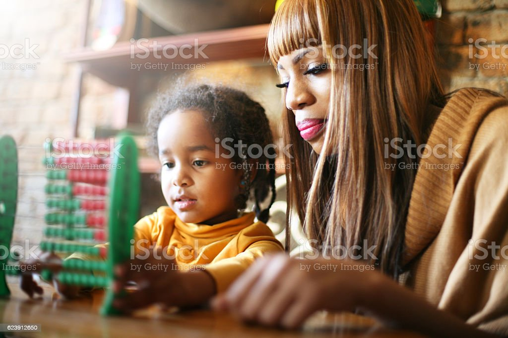Mother and daughter educate. stock photo