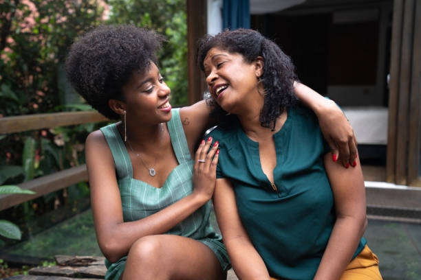 Mother and Daughter Embracing at Home I Love You Mom afro caribbean ethnicity stock pictures, royalty-free photos & images
