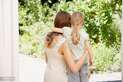466231012istockphoto A mother and daughter embracing looking at some wildlife 75593735