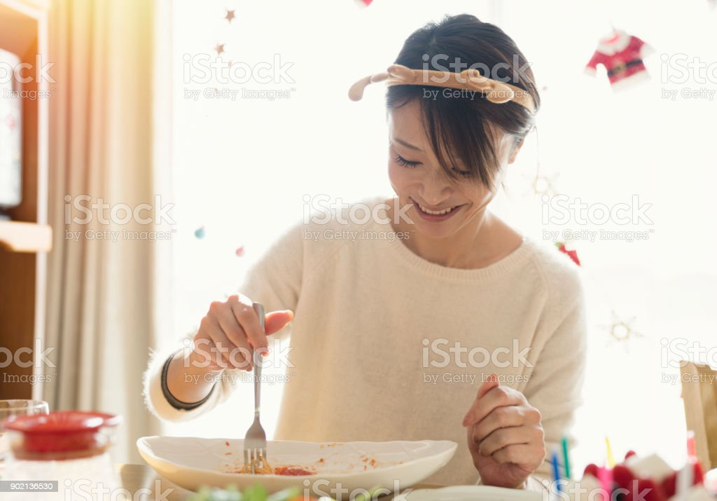 Mother and daughter enjoy eating christmas food stock photo