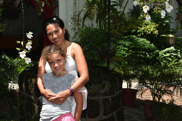 mother and daughter enjoy the back streets of manila, philippines - philippines girl stock photos and pictures
