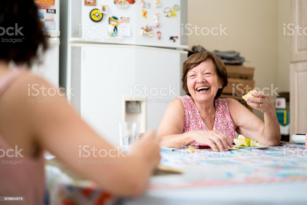 Mother and daughter enjoying a great time together in the kitchen stock photo