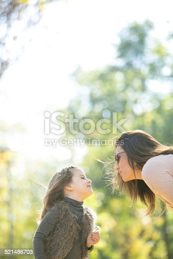 Mother and daughter enjoying autumn day outdoors
