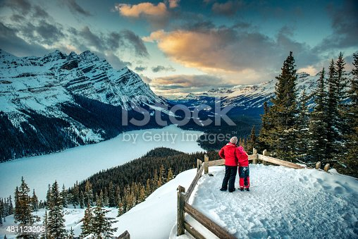 Mother and Daughter enjoying the winter views of Peyto Lake in Banff National park. Canada.