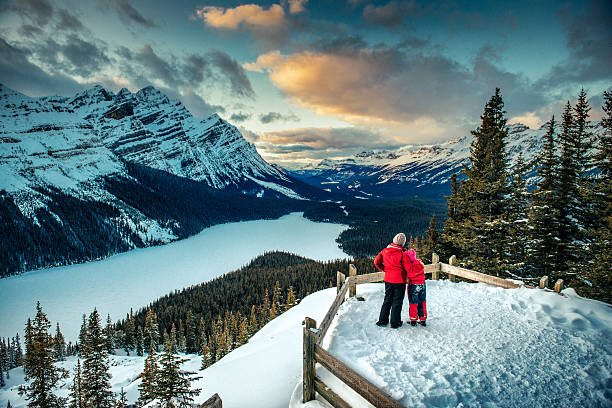 mother and daughter enjoying banff national park in winter - canada travel stock photos and pictures