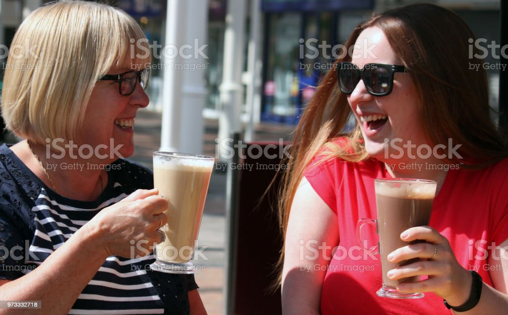 Mother and Daughter enjoying coffee stock photo