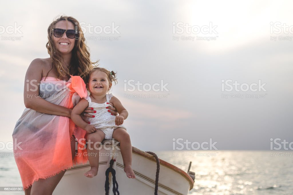Mother and daughter enjoying day at beach royalty-free stock photo