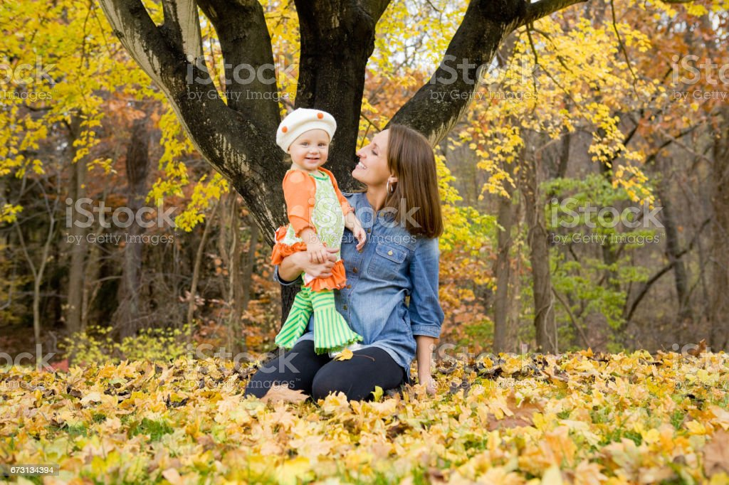 Mother And Daughter Enjoying Fall Day stock photo