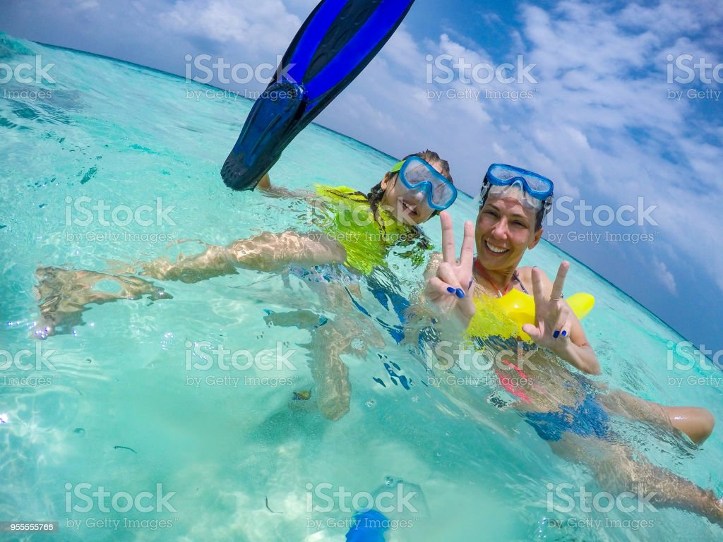 3f54568ce6b7e Mother and Daughter Enjoying in Sea on Summer Vacations - Stock image .