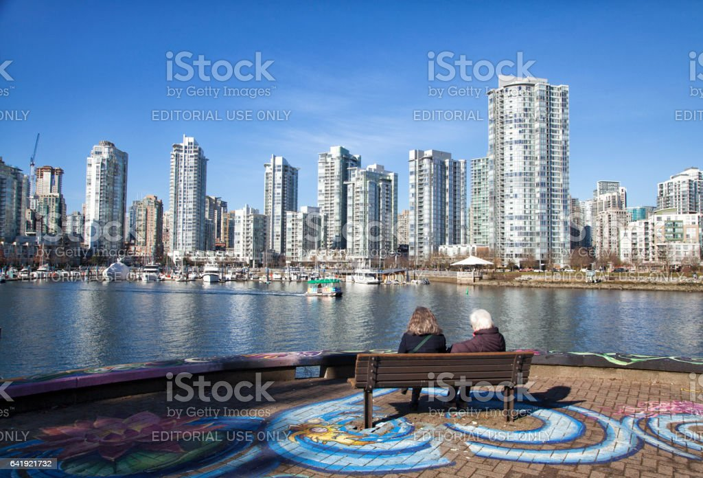 Mother and daughter enjoying the view at False Creek in winter,Vancouver,Canada stock photo
