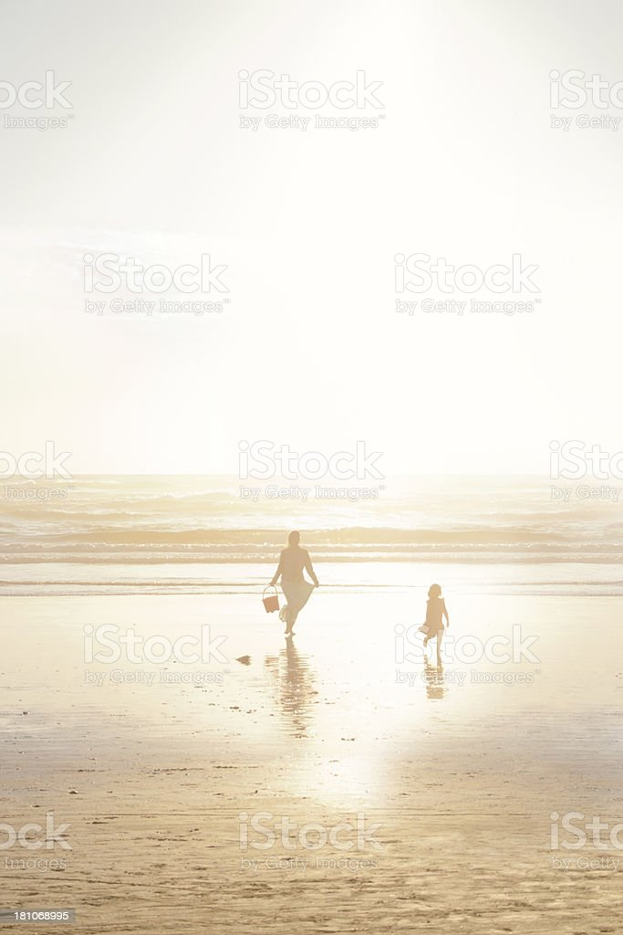 Mother and Daughter Enjoying Time Together On A Beach royalty-free stock photo